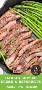 Steak and garlic asparagus cooked in a black cast iron pan.