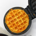 Cooked Chaffle on a black Dash Mini Waffle Maker