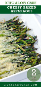 Baked Asparagus with Parmesan in a white baking dish.