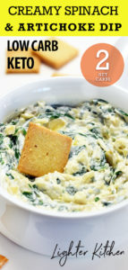 Baked Keto Spinach Dip in a white soup bowl. Rests on a white plate with keto crackers.